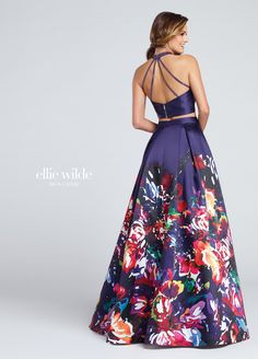 Ellie Wilde EW117005 - Two-piece Mikado and signature print Mikado dress set, halter cropped top with exposed zipper features heat-set stone high collar and multiple back straps, high waist printed box pleated full A-line skirt with side pockets. Sister dress to styles EW117001, EW117002, EW117003, EW117004 and EW117006.
