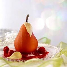 Red cinnamon candies add a pink blush to these poached pears. Serve them warm for breakfast, or with cookies for a sopisticated dessert.