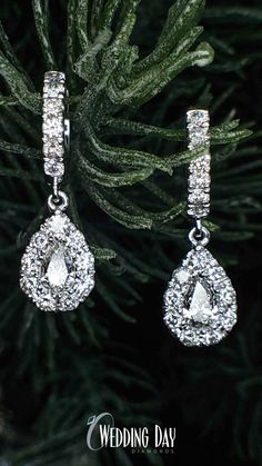18a7fe6bf These breath-taking drop earrings are show stoppers with 2 pear shaped  diamonds totalling 1