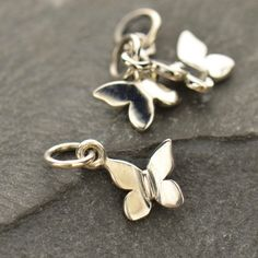 A personal favorite from my Etsy shop https://www.etsy.com/listing/281508510/sterling-silver-tiny-butterfly-charm