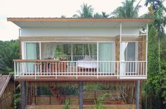 No photo description available. House With Balcony, Backyard House, Simple House Plans, Tiny House Plans, Jamaica House, Beach House Colors, Thai House, House On Stilts, Shed Homes