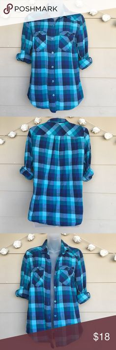 Kirra • Teal & Dark Blue Plaid Button Down Shirt Kirra • Teal & Dark Blue Plaid Button Down Shirt  —Size = Medium  —In Good Pre-Owned Condition! —Multi Color Blue plaid pattern. Button down style with 2 front pockets. Sleeves can be rolled up or left down. Has intentional poking all over, as shown. —Approx. measurements laying flat(buttoned): •Armpit to armpit=19in  •Length=26in  •Sleeves=23in    ?? Questions ?? — Please ask!  •All packages shipped fast with love & care! Kirra Tops Button…