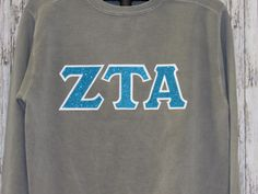 gray crewneck sweatshirt with aqua glitter sorority double stitched letters by mainstreetsorority on etsy