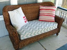 stained and recushioned wicker sofa.