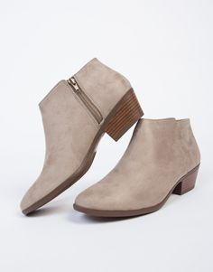 Booties booties rockin' everywhere! These taupe Suede Wooden Heel Booties are perfect for any day out. Pair these ankle booties with a cold shoulder romper and accessorize with a round crossbody bag.