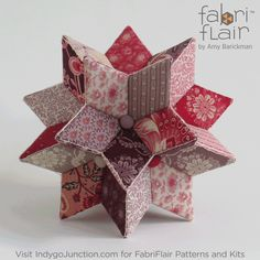 Our Centerpiece Star Pattern in the fabric by All of our Fabriflair patterns and kits are designed with precuts in mind so you can enjoy every fabric in your favorite lines! Quilted Christmas Ornaments, Christmas Origami, Diy Craft Projects, Sewing Projects, Dimensional Shapes, Quilting For Beginners, Star Ornament, English Paper Piecing, Sewing Rooms