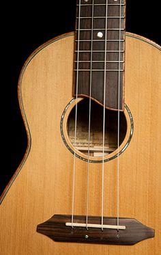 Handmade Concert Ukulele, cedar top with Paua Abalone rosette... like the bridge