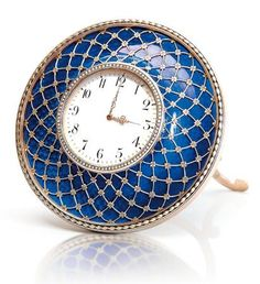 This incredibly beautiful table clock is the highlight Faberge object of this auction season!. It