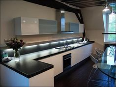 Kitchen, Sophisticated Lighting Applied In Modern Kitchen Design With Black Granite Countertop Plus White Kitchen Cabinet: Get Exclusive Imp...
