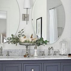 We love how our Pearson Sconce looks in the bathroom from @dearlillie.  Simple, clean lines and slim profile make it the perfect choice in this classic and romantic bathroom. #bathroom #lighting #classicdesign #interiordesign