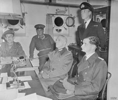 Liberation: German representatives Major-General Heine and Lieutenant-Commander Arnim Zimmerman aboard HMS BULLDOG off Guernsey before the final signing of the instrument of surrender.