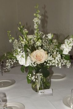 Simple Petal vases with ribbon detail, natural flowers in Ruthin castle www.weddingflowersbylaura.com www.ruthincastle.co.uk