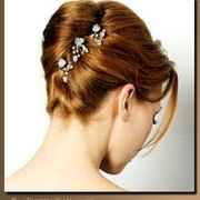 What do you guys think about doing a french twist in your hair with some added flowers?