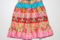 A jelly roll skirt!!  I think I'll try this for my girls...and maybe one for me, too!