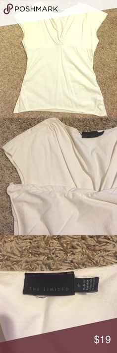 Capped blouse Very cute top that goes with just about anything. The sides of the shirt are bunched together which makes any body type very flattering. EUC The Limited Tops Blouses