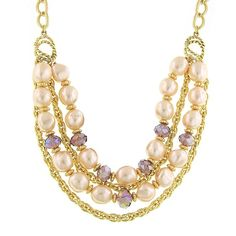 A serious statement necklace for a serious fashionista! A delicately detailed golden double curb chain suspends a smart and stylish combination of soft champagne simulated baroque pearls and light amethyst glass beads that add a touch of feminine power among bold metallic gold chains. The perfect mix of hard and soft style in one wow-worthy necklace! Part of our Signature 1928 Core Collection.