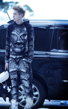 Kris from exo..how someone can still look sexy while wearing this...the world may never know.
