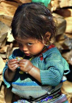 THE PHOTOGRAPHER GAVE THIS LITTLE GIRL SOMETHING TO EAT.......SHE WAS SO HAPPY --- BUT, DIDN'T KNOW HOW TO EXPRESS IT............ccp
