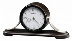 Chiming Mantel Clocks Howard Miller Black Quartz Mantel Clocks 635159-Contemporary wood and metal mantel clock with curved brushed nickel finished metal sides is finished in Black Coffee on select hardwoods and veneers.