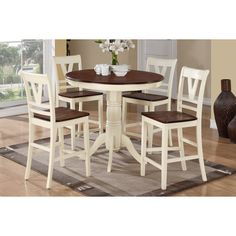 This blushing 5-piece counter height dining set design of cottage decor is filled with light and airy color accented with rich dark hues. The round cherry wood table top is trimmed in an off-white frame with beautiful embellished legs.