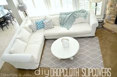 Make slipcovers from drop clothes. Great for very large couches and sectionals!