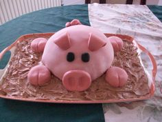 Pig Cake. The body is made of marble cake and was cooked in a dish to give it the dome shape. Each foot is a chocolate cupcake covered in the same fondant as the main body and is hand moulded to give the trotter shape. The other features of the pig...