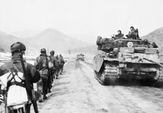 Centurion tanks and men of the Gloucestershire Regiment advancing to attack Hill 327 in Korea.