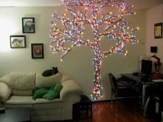 Christmas tree made from push pins, yarn and lights - WOW!!!! if i didnt just fix all the holes id do this in 5 seconds!!!