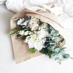 This bouquet is so simple and elegant. White blooms with green hues.