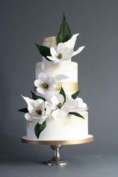 Magnolia wedding cake #weddingcakes
