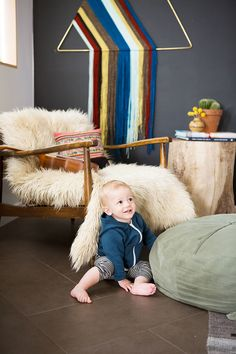 Little boy in his non-traditional nursery with desert-inspired décor