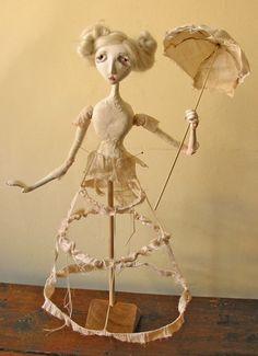 Blackeyedsuzie makes amazing art dolls, and sells on etsy.