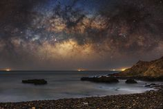 Dusty but clear - Milky Way hanging at the edge of the ocean. Photography by Timmy Wong
