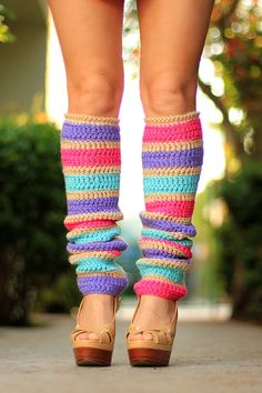 Inspired by the lively colors of flower blossoms, these fabulous fashion leg warmers feature lovely stripes of fuchsia, lavender, and aqua too!!...and a nude-colored accent yarn is just the thing to really make the gorgeous hues pop!! Pull them up to the knee, or wear them