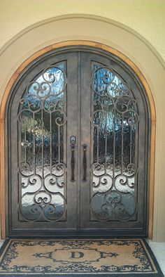 arched double entry doors with iron work