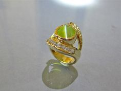 One of a kind Cat's eye chrysoberyl and diamond ring by Glenn Dizon Designs.  Created for one of my collectors.  I would love to create something for you too.