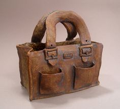 Ceramic Handbag Sculpture, 5 x 2.5 x 5 inches. Available on Etsy.