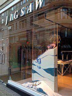 VM choice: Jigsaw's slice of sand window display - Retail Design World