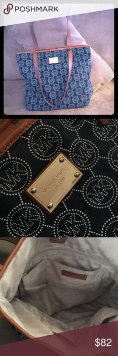 Michael Kors Canvas Tote Fabulous Michael Kors tote with lots of room and pockets. Navy blue canvas, white print and brown leather straps, trim and closure. Measures approximately 15.5 x 12.5 x 4.5. Like new condition!! Michael Kors Bags Totes