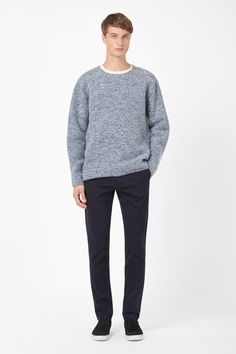This jumper is made from boiled wool for a modern structured shape and speckled melange finish. A relaxed fit with oversized proportions, it has long raglan sleeves and clean, modern edges.