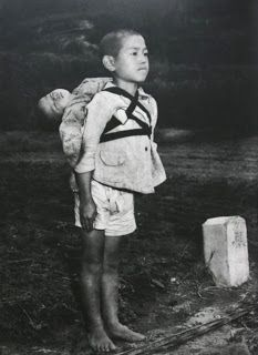 Real-life Grave of the Fireflies: Stoic Japanese orphan, standing at attention having brought his dead younger brother to a cremation pyre, Nagasaki, by American photographer, Joe O'Donnell 1945 (One of the many sad things about war. Nagasaki, Post Mortem, World History, World War Ii, Grave Of The Fireflies, Standing At Attention, Rare Historical Photos, Iwo Jima, Japanese Boy