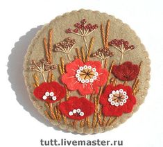 Some very nice examples of flowers and brooches