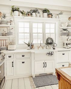 This white rustic farmhouse kitchen is lovely! ❤️ Would you love a kitchen like this? 🙋 TAG a friend who will want this kitchen! Farmhouse Kitchen Decor, Kitchen Redo, Home Decor Kitchen, New Kitchen, Home Kitchens, Kitchen Remodel, White Farmhouse, Kitchen Ideas, Farmhouse Homes