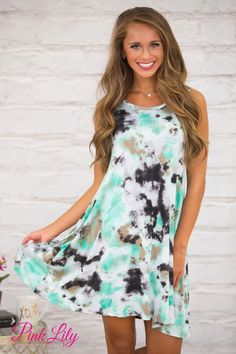 This bold dress is so perfect for you to rock at your next girls night out or backyard cookout! Featuring a bright green, grey, taupe, and black tie dye style print, this unique color combination will stand out in a crowd!