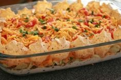 Awesome Mexican Dip  1 Can chili w/beans  1 8oz. pckg cream cheese  1 brick Pepper Jack cheese shredded  In a glass dish, layer spread cream cheese then chili,then shredded cheese.Put in microwave for 5 min. or until cheese is melted.Serve w/Tortilla chips.