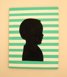 Another clever idea for making a silhouette canvas by painting stripes, printing out the profile picture, tracing around the edges and then painting inside the lines. So sweet.