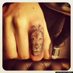 Little lion tattoo. Love the idea not the placing though