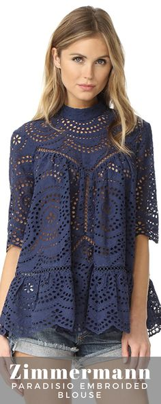 A voluminous Zimmermann blouse with a flounced hem, rendered in elaborate eyelet. Four-button placket in back. Half Sleeves, Tunics, Button, Womens Fashion, Fabric, Sweaters, Tops, Style, Search