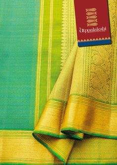 Waves of happiness plays a central theme on this azure blue over the Chartreuse green saree. Fine detailing in gold zari on the pallu -columns of rudraksh beads intersperses an elegant array of birds and gentle rolling waves. More of the golden wavy arrangement on the border. #Sareeoftheday#Silksaree#Kancheevaramsilksaree#Kanchipuramsilks#Ethinc#Indian #traditional #dress#wedding #silk#saree#craftsmanship #weaving#Chennai #boutique#vibrant#exquisit #pure #weddingsaree#sareedesign#colorful…