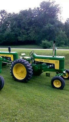 John Deere two cylinder model 730 electric start diesel row crop with adjustable wide front end.